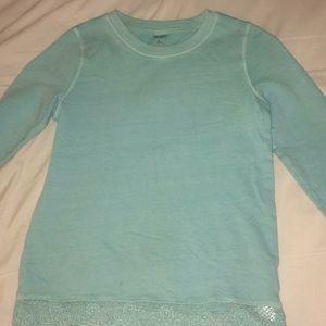 A blue plan long sleeved shirt